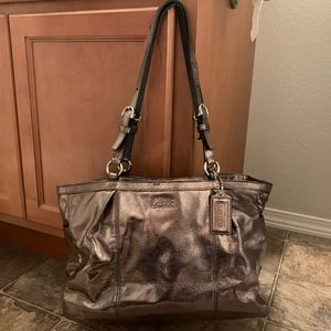 Metallic silver coach purse with matching wallet